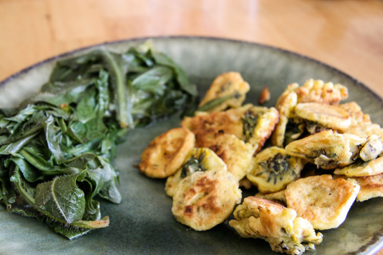 Dandelion fritters with steamed dandelion and cat's ear greens